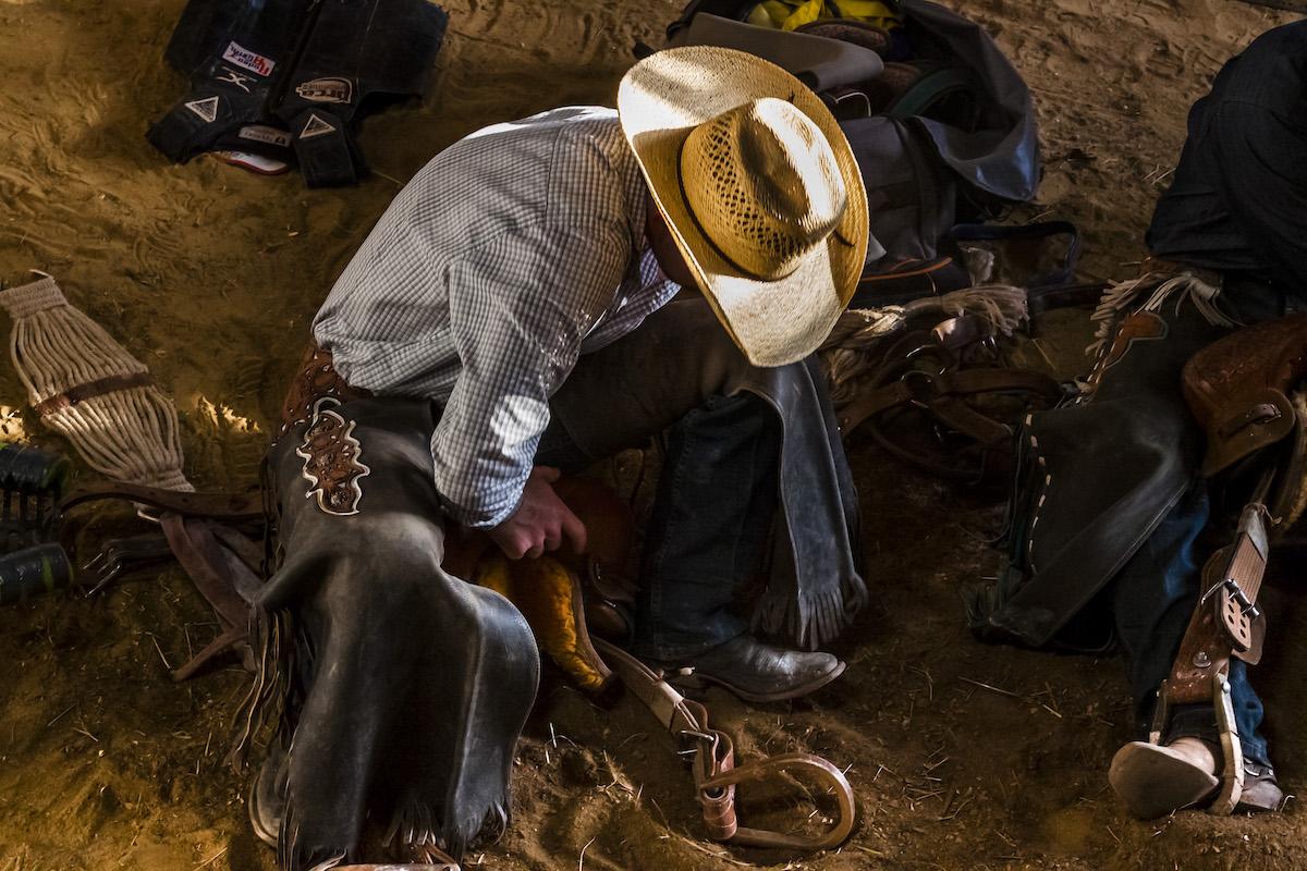 Saddle bronch rider; rodeo cowboy