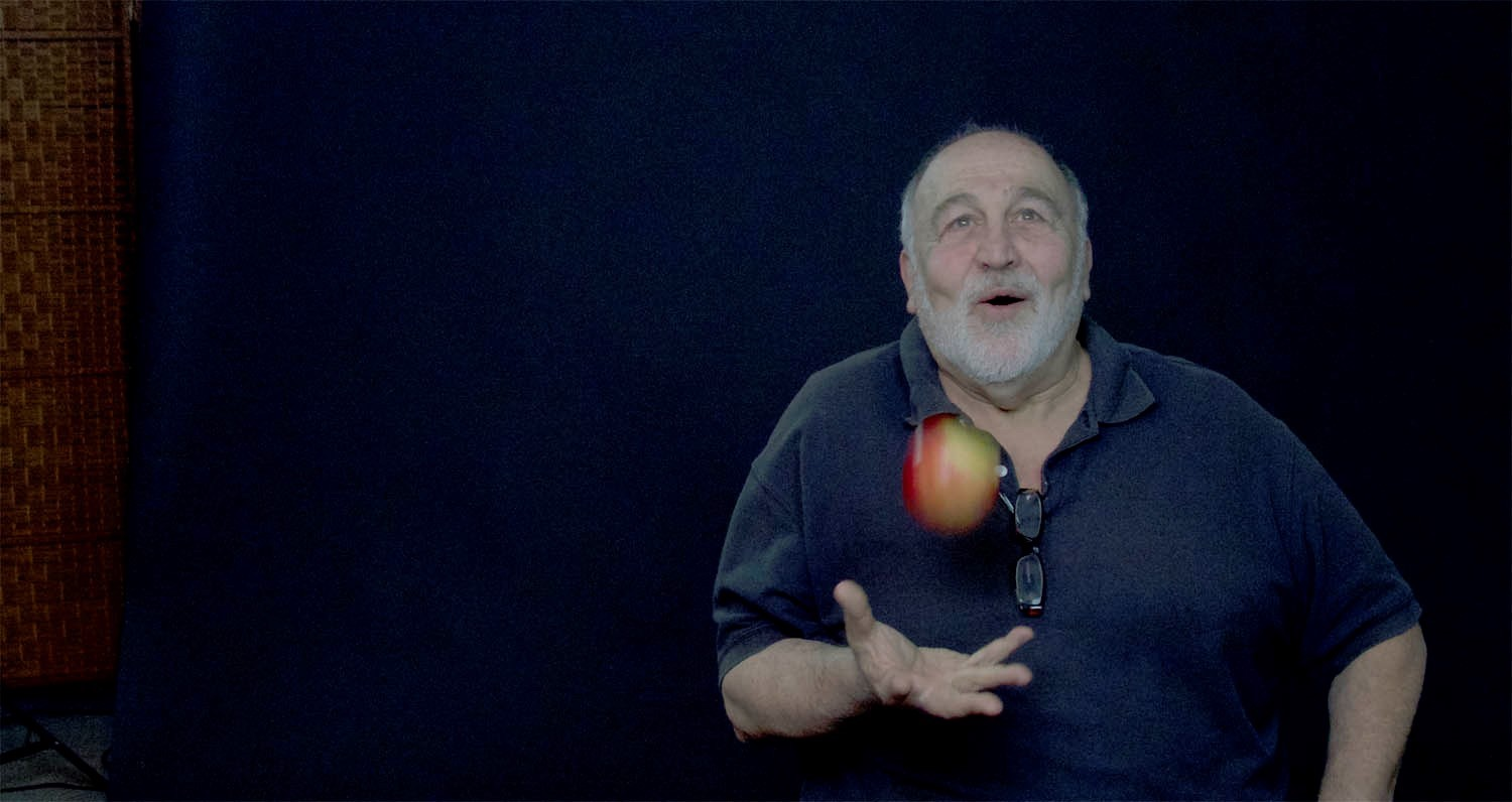 Jack Grapes with Apple. Photo by Alexis Rhone Fancher