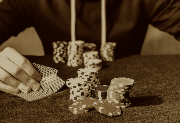 Playing poker in sepia tones.