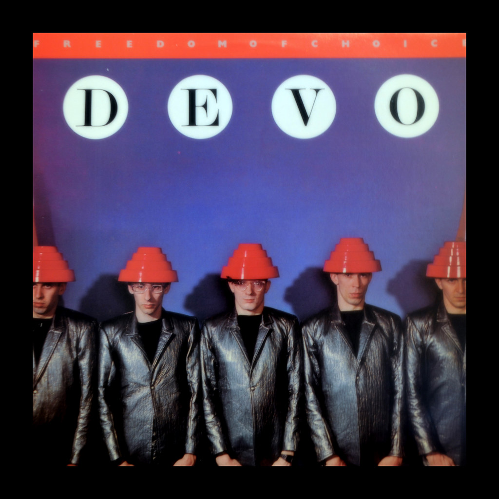 the iconic album cover for Devo's Freedom of Choice, featuring the five men in their trademark red plastic geometric hats.